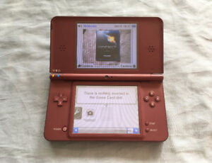 Nintendo DSi XL + New Charger + Games Like New