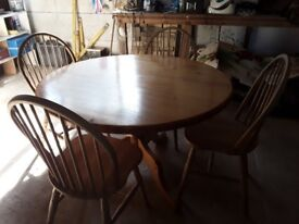 pine farm house table and 4 wheel back chairs