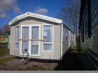 Willerby Winchester with Chateaux Rigid Vinyl Cladding and Outlook French Doors
