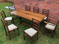 Scottish Country Refectory Table, 8 chairs and Sideboard in Dark Oak with carved legs and cupboards