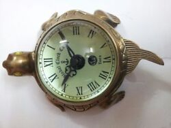 ANTIQUE BRASS WALL CLOCK IN HANGING REENACTMENT & TABLE TOP TORTOISE SHAPE DECOR