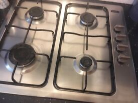 Integrated gas oven and hob