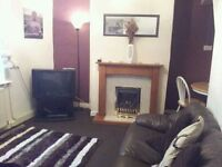 Spacious 2 bedroomed, partially furnished terraced house for rent with 2 reception rooms