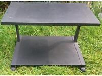 Black small low table and shelf for television and dvd player