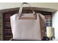 beige tote bag with gold trim