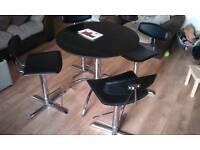 Black granite table and 4 gas adjustable stools