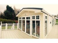 Immaculate 6-berth static caravan with sea views, private garden and stunning sunsets
