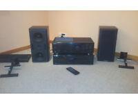 Kenwood 5-disc C.D changer, Kenwood Amp, Mission 2-way speakers, AVF speaker wall mounts.