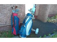 Golf clubs 2 bags and 1 golf trolly