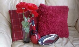 RED CUSHIONS, LAMP, DAISY ARRANGEMENT, SILVER BOWL