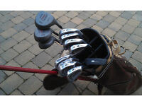 Set of Malibu golf clubs with bag and trolley