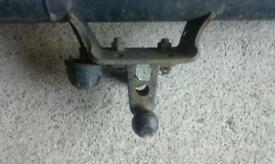 Van tow bar and a step