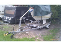 Flat bed trailer twin axle braked (with 17 ft sailing boat - fibre glass)