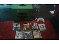 X box one boxed with 7 top games