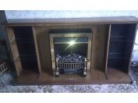 Retro wooden fire surround, hearth, mantle-piece, electrically lit shelving unit