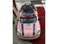 Child's battery operated sit in car