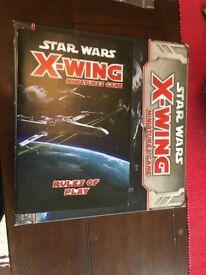 Star Wars X-Wing Miniature Game starter set.