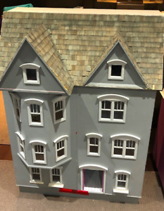elegant wooden dollhouse