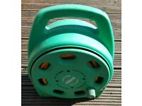 For sale is a Hozelock 2-in-1 compact hose reel.