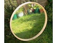 Large round mirror, plastic beige frame, wood back