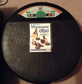 Vibroplate exercise machine with DVD and resistance bands