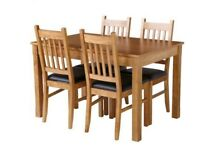 Oak extendable sturdy dining table and 4 chairs in very good condition