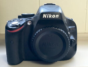 Nikon DSLR with Two Lenses and Extras