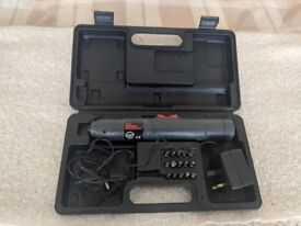 Cordless screwdriver with charger and full set of attachments in black plastic case.
