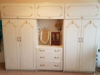 White Vintage wardrobes with dressing area, drawers and hanging space.