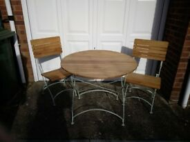 Solid Slatted Wood and Metal Circular Garden Table and 2 Chairs - fully collapsible for easy storage