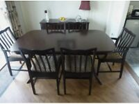 Beautiful mahogany dinning room table with 6 chairs