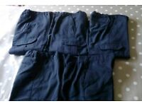 Five pairs of 5-6 year charcoal grey school trousers with adjustable waistband.