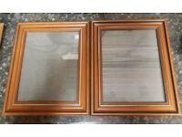 Two picture frames with detailing.