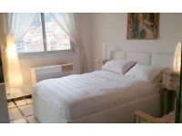 Beautiful, White Leather Ottoman Storage Bed with Mattress and headboard