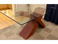 Glass top dining table sits 6