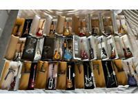 24 mini display guitars boxed