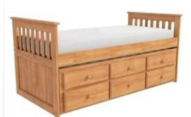 Single bed with pullout n storage underneath