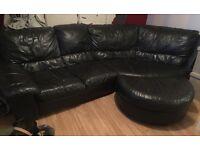 Black corner leather sofa and foot stool