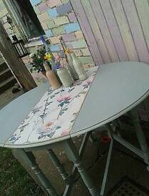 Unique upcycled drop leaf dining table