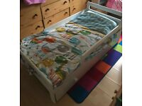 Toddlers bed with pull out drawer