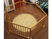 Large wooden playpen.