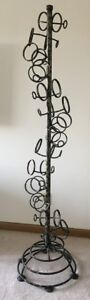 Original, hand crafted wrought iron wine sculpture rack
