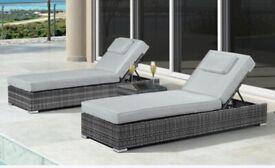Grey rattan sunbeds