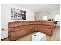 Harvey's corner group sofa for sale. The sofa is in excellent condition and has two recliners.