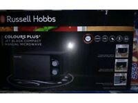A brand new Russell hobbs microwave for sale