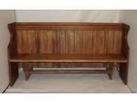 Refurbished solid wood pew with new slanted refurbished wooden arms
