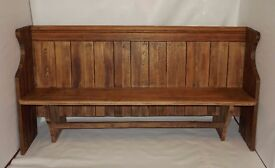 Refurbished solid wood pew with new slanted modern arms