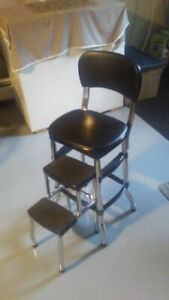 BLACK CHAIR WITH A BUILT IN STEP STOOL