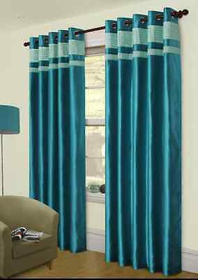 Turquoise curtains on pole.