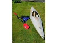 Kayak with oar and cover